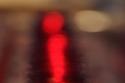 شموع حمراء في زجاج أحمر