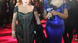 بوسي شلبي تتألق بفستان أزرق من تصميم فؤاد سركيس
