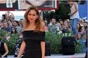 نيللي كريم تتألق على السجادة الحمراء بمهرجان فينيسيا بجمبسوت أسود غاية في الأناقة