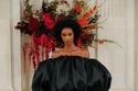 فستان أسود منفوش من مجموعة Carolina Herrera ربيع وصيف 2022