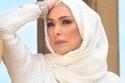 استمعوا لأمل حجازي تنشد مع أبنائها في الشارع في أحدث ظهور