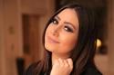 تفاصيل القبض على المغنية المصرية بوسي