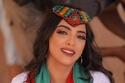 سحر المغرب العربي: تألقي بالقفطان على طريقة الفنانة رقية ماغي