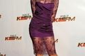 كاتي بيري في فستان بنفسجي على السجادة الحمراء