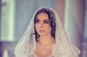 صور فستان زفاف ملكة جمال عربية يخطف الأنظار بفخامته وتصميمه الخيالي