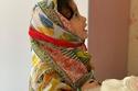 ابنة مريم حسين بغطاء الشعر