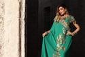 أمل العوضي بفستان أخضر فاخر للمصممة عاليه السهيم