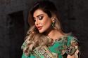 أمل العوضي في إطلالتها الأولى بفستان أخضر فاخر