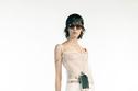 إطلالة باللون الأبيض مع بلوزة شفافة من Givenchy