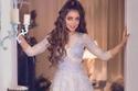 بلقيس فتحي بفستان ساحر من تصميم طارق سنو بالألوان الباستيلية