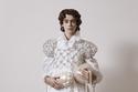 فستان أبيض بكشكشة من Simone Rocha