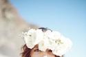 24 طريقة مثالية للتألق بتسريحات ورد في زفافك