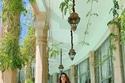 إطلالات روان بن حسين الصيفية: فستان ناعم بلون الورد