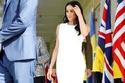 الفستان الابيض يكشف بروز بطن ميغان ماركل بعد إعلان حملها