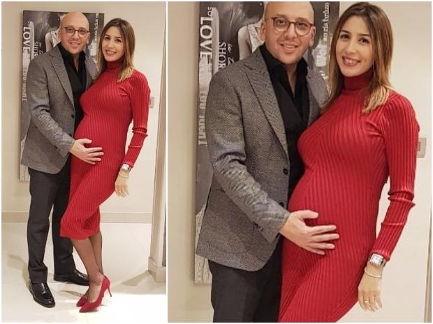 جنات بفستان أحمر ضيق قصير يكشف تغيراً ملحوظاً قوامها بسبب حملها