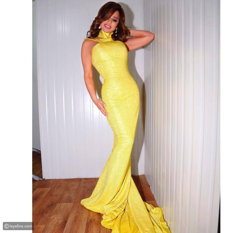 فستان نجوى كرم باللون الأصفر في مهرجان الأرز الدولي