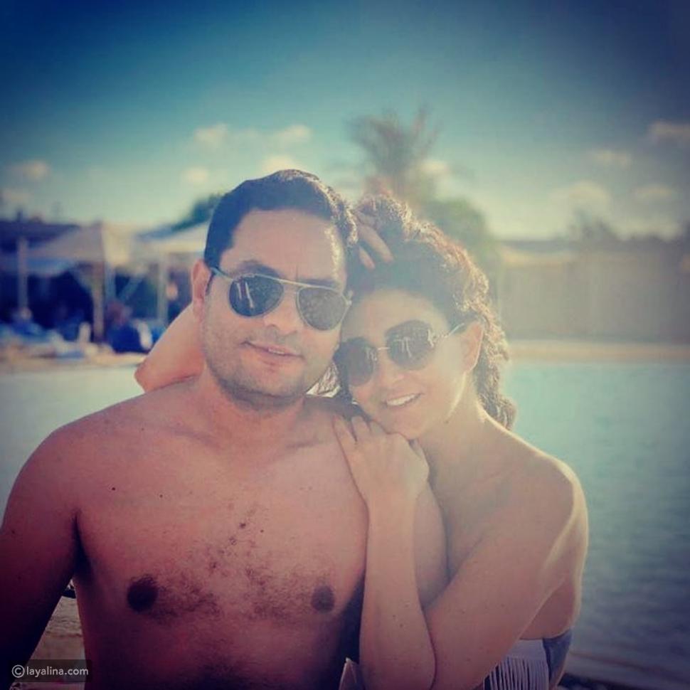 غادة عبد الرازق وزوجها هيثم زنيتا من إجازتهما الصيفية
