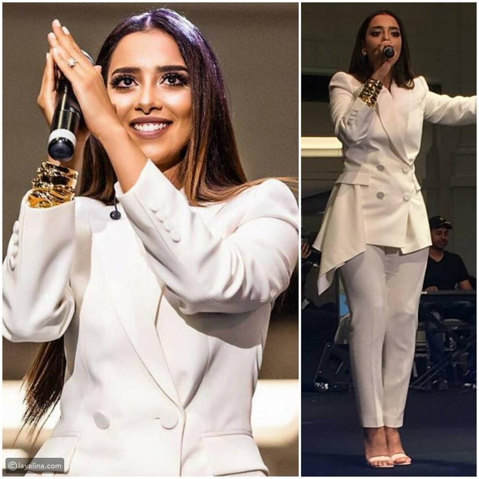 بلقيس فتحي ترتدي بدلة نسائية باللون الأبيض في حفل مول الإمارات