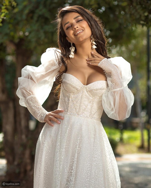 فساتين الزفاف ذات الأكمام المنفوخة الأنسب لشكل قوامك
