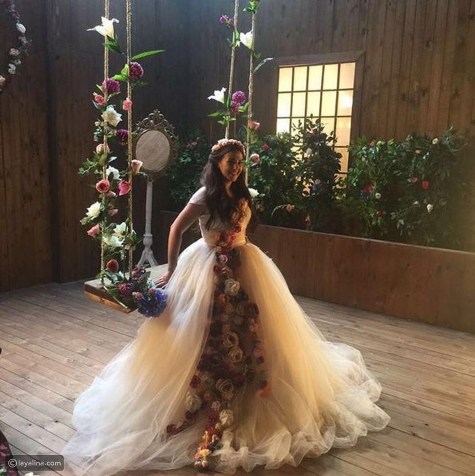 """صور دنيا سمير غانم بفستان ملكي مزيّن بالورود في إعلان """"ارسم قلب"""""""