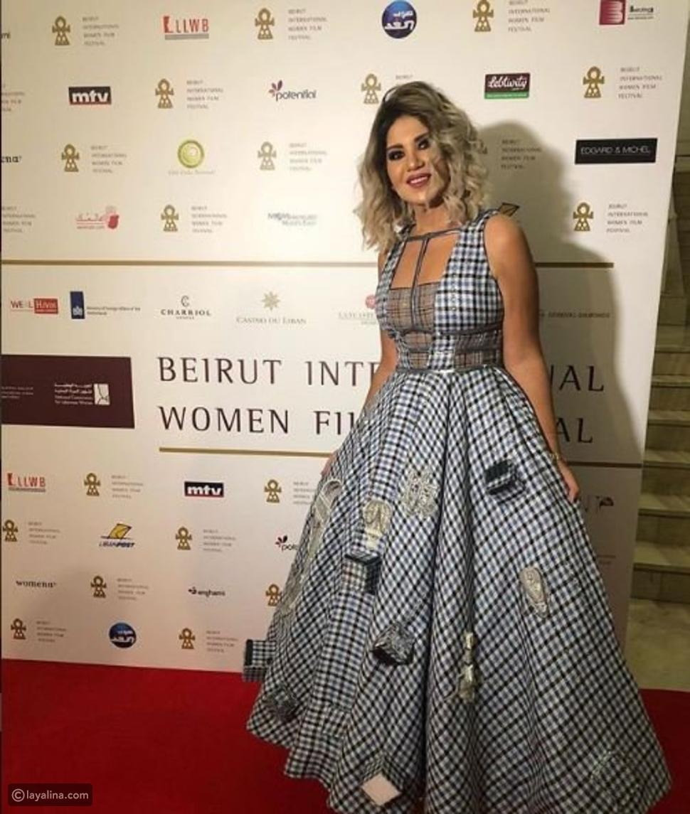 بوسي شلبي تتألق بفستان من مجموعة حسن إدريس