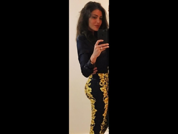 اكتفت ريهام حجاج بنشر صورتها دون الكشف عن وجه زوجها