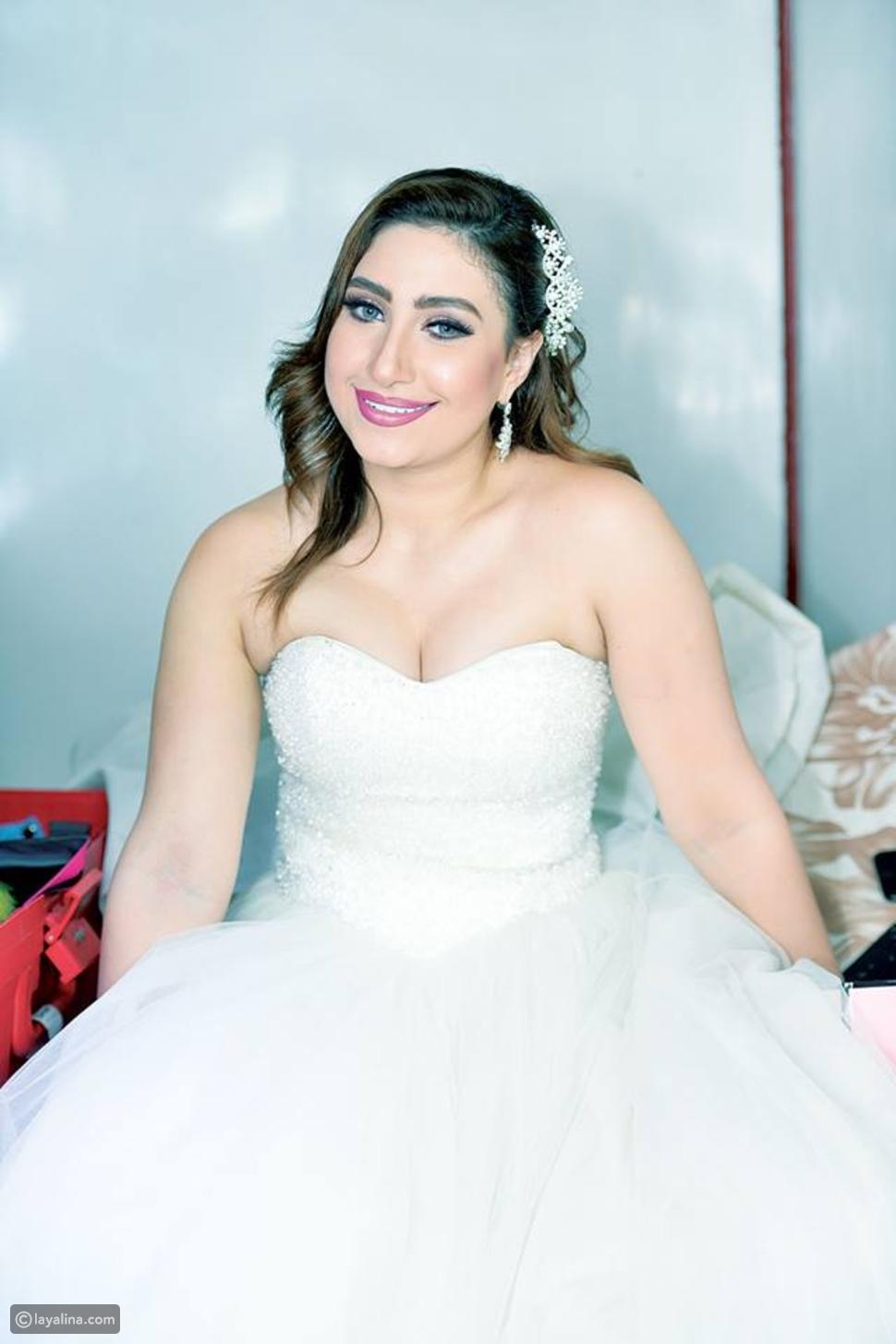 بوسي ترتدي فستان الزفاف