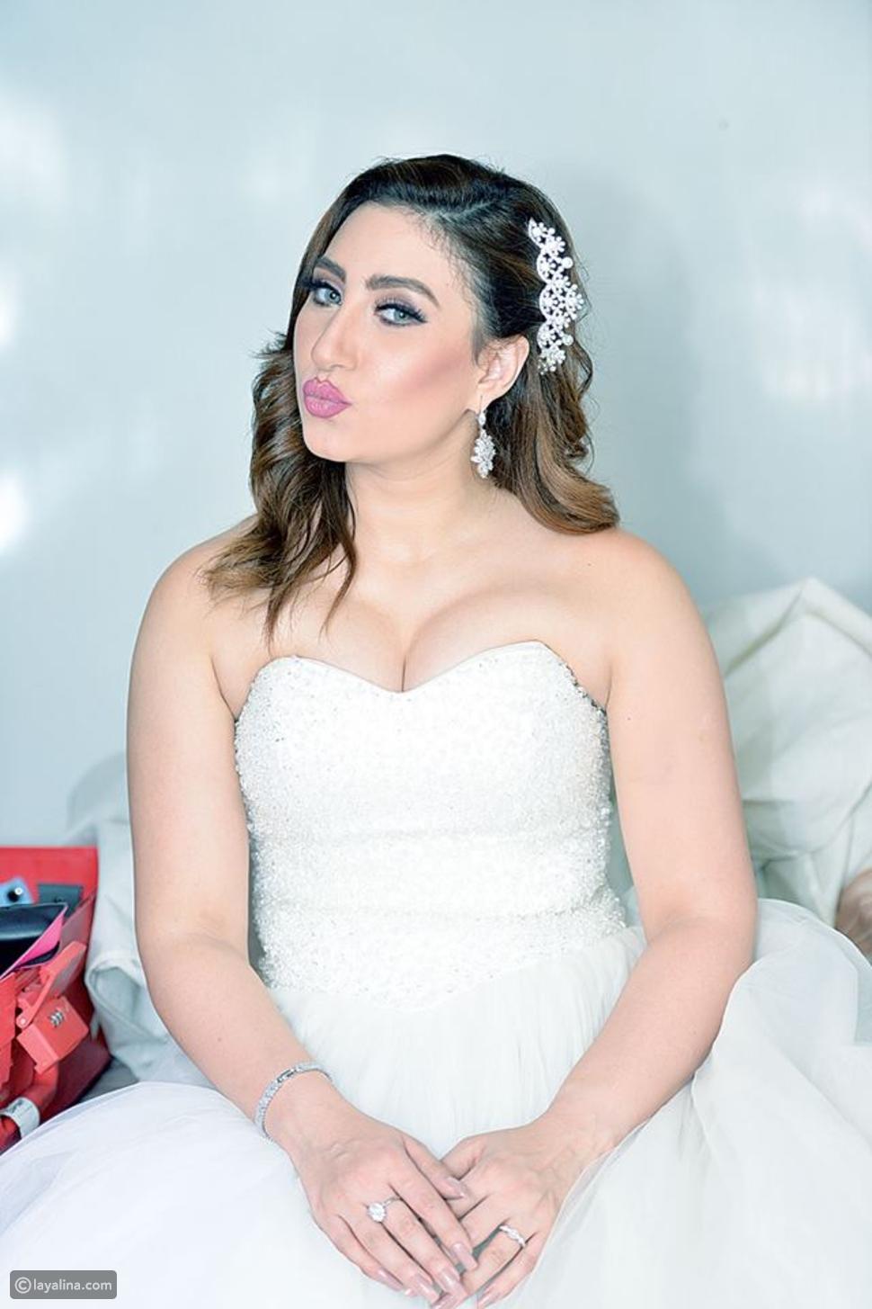 بوسي بفستان الزفاف