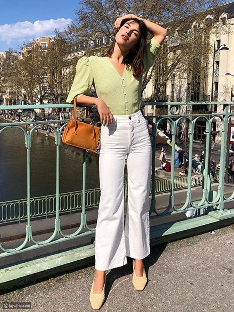 لون الأخضر الفستق مع البنطلون الجينز