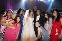 الفنان هشام عباس مع العروسين كريم وسلمى والأصدقاء