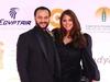 أحمد الفيشاوي يثير الجدل مجدداً بقبلة زوجته في ختام القاهرة السينمائي